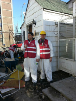 MHA-NYC employees volunteering for a muck-out in the Rockaways, January 2013